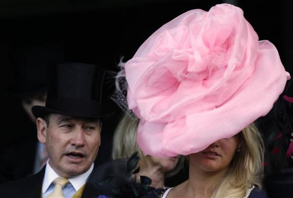 Racegoers sit in the stands before The St James's Palace Stakes on the first day of racing at Royal Ascot in southern England